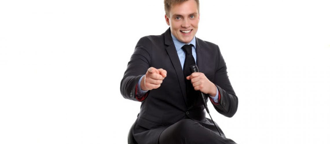 Trust me, you can do it!  Attractive man with a microphone is delivering a motivational speech.