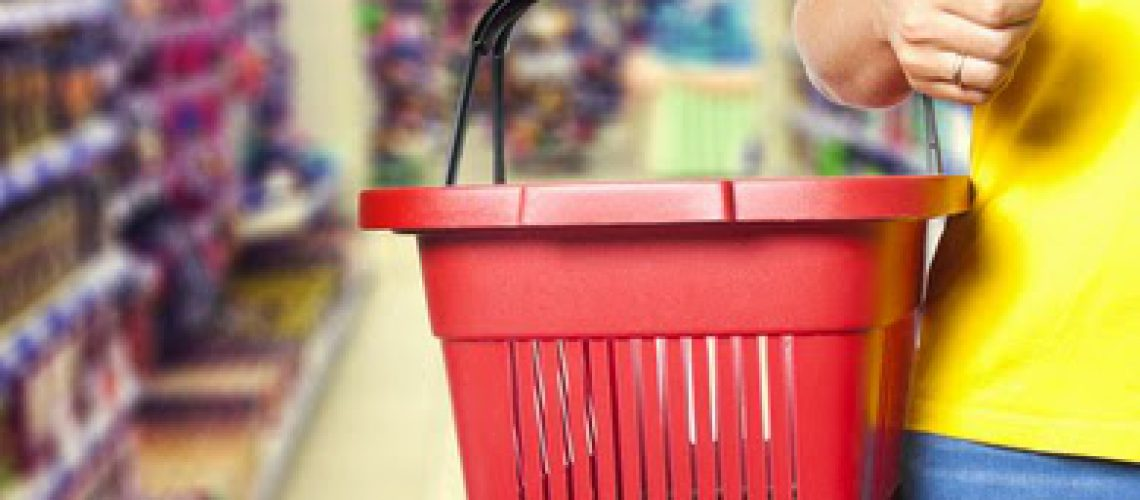 Women  holding empty shopping basket - Shopping concept